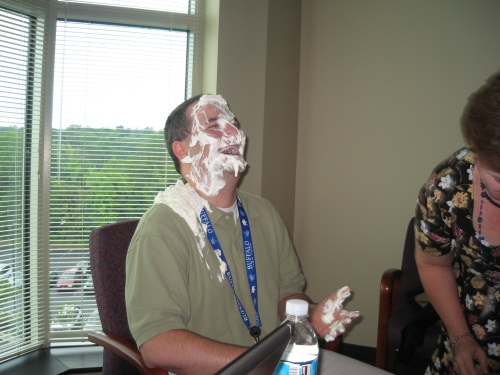 Chris gets hit in the face with a pie