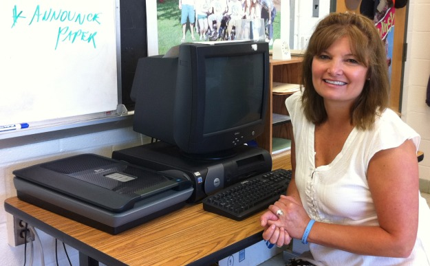 picture of Cynthia next to a computer and scanner