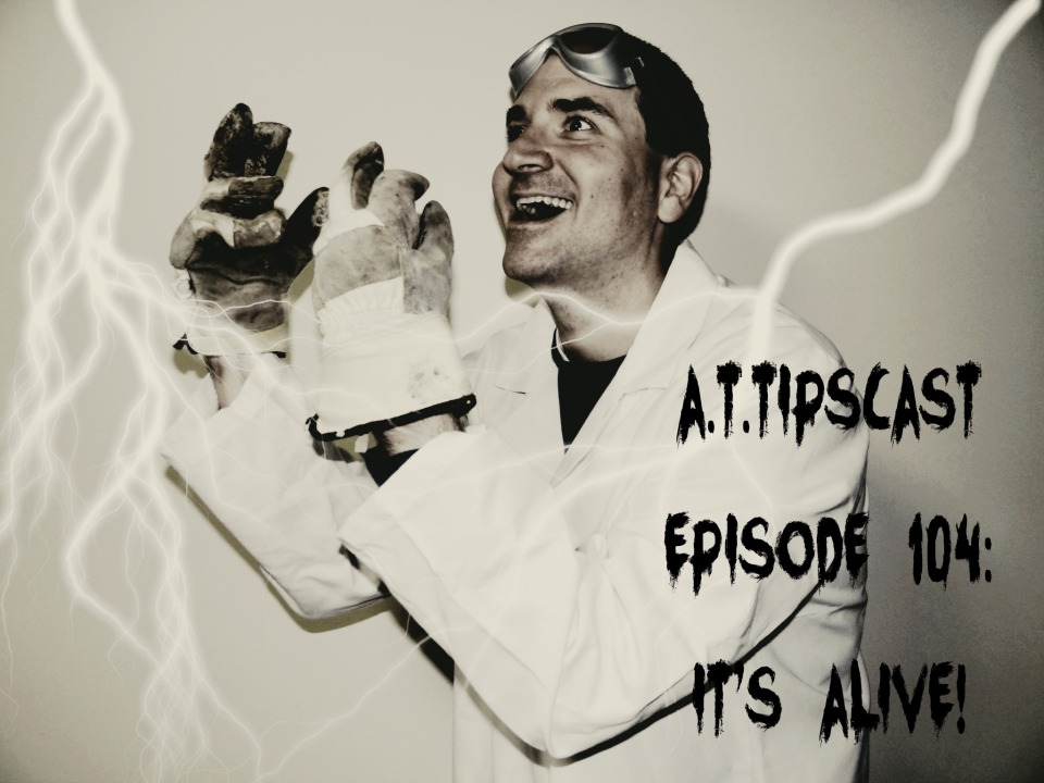 "Black and white pic of Chris dressed in a lab coat with gloves on his hands and goggles on his forehead looking crazed as he gazes off into the sky. He is surrounded by lightning and there is text in the foreground in a creepy font that reads ""A.T.TIPSCAST Episode 104: It's Alive""."