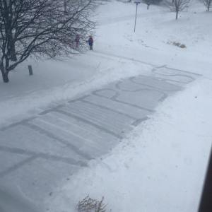 Driveway shoveled to spell A.T.TIPSCAST